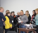 A group of journalists watches the instructor explaining the drone