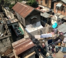 Dwellings in Mandalay - one has a satellite dish