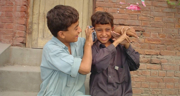 Boys listening to a handheld radio