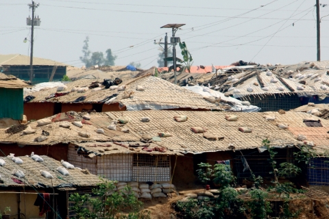 shacks with sand bags on the roofs
