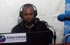 Amadou Korka Bah at the mic and a laptop