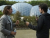 Gustavo (R) interviews a man - white domes in the background