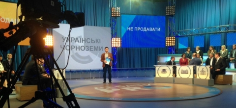 In a TV studio, a program is being recorded