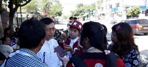 Participants in the Internews Election Reporting News Lab interview a polling station official in Mandalay on November 8, 2015, election day.