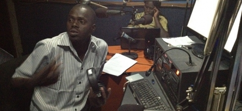 Abyei Today Editor Karbino Dut, and Presenter Rose Monjtoch make last minute adjustments before going on air.