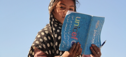 A young girl reads a book