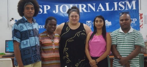 "Two men and three women stand in front of a banner that says ""USP Journalism"""