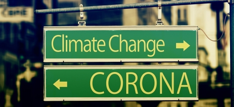 "Two street signs: one says ""Climate Change"" and the other says ""Corona"""
