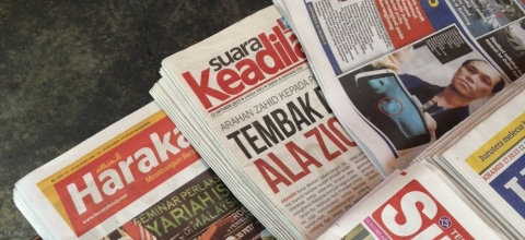 A stack of newspapers in Malaysian