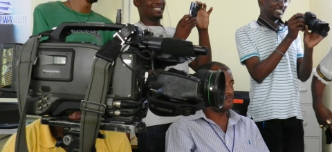 Five journalists with cameras and video cameras