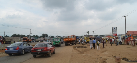 Street in NIgeria with stores and people walking