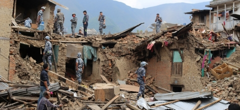 Military personnel look at earthquake damage in Nepal