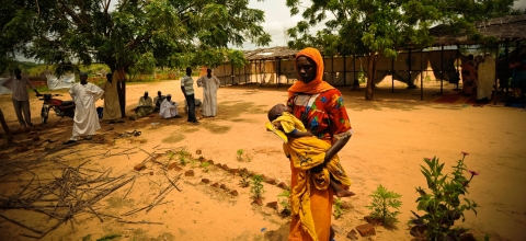 A woman brings her baby to a free clinic at Gouroukoun IDP camp in eastern Chad